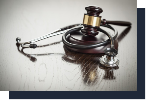 justice gavel with stethoscope on top | Kenneth M. Sigelman & Associates | San Diego, CA